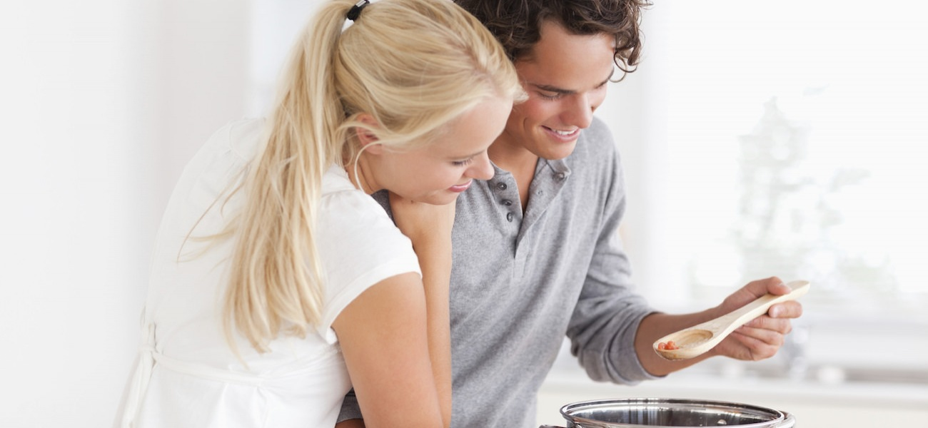 Homepage rotator with couple cooking together in very bright kitchen